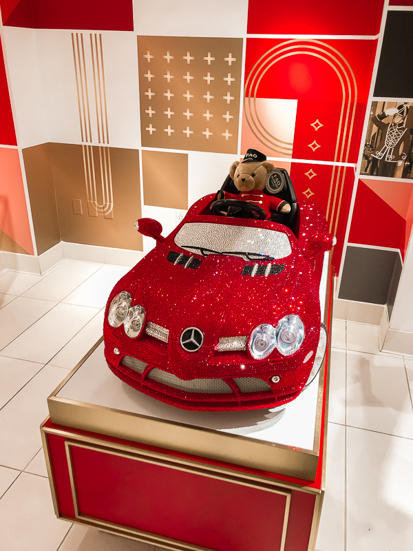 Teddy Bear in a toy car at FAO Schwarz.