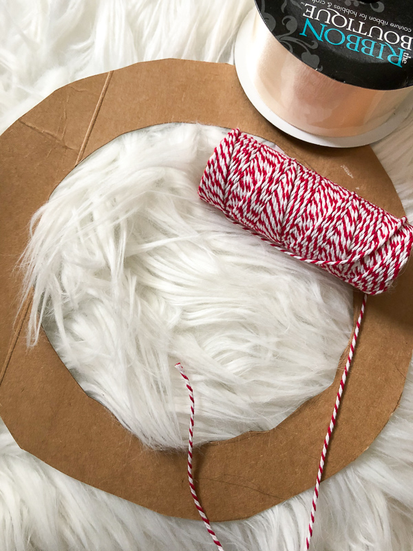 Circular cardboard cutout for the DIY dog wreath.