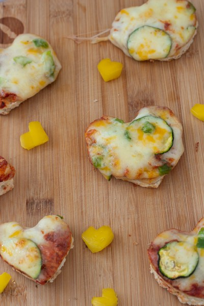 Heart-shaped pizza bites and yellow bell peppers.