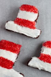 The Cat in the Hat Brownies with red sprinkles and white frosting.