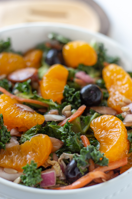 Mandarin orange slices on top of a green salad.
