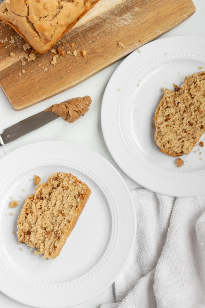 Slices of peanut butter bread on white plates.