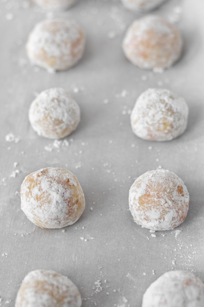 Unbaked cookies rolled in powdered sugar.