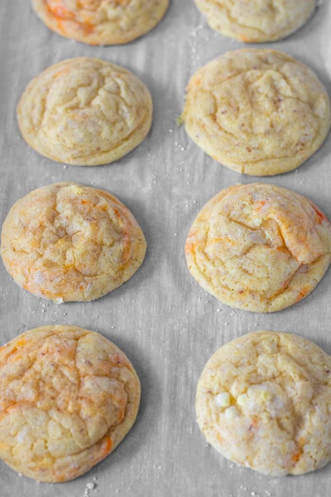 Baked soft orange sugar cookies.