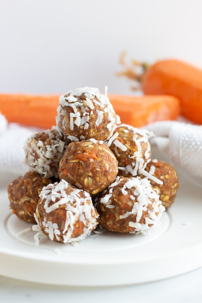 Carrot cake energy bites on a white plate.