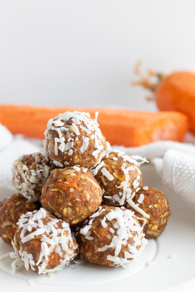 Carrot cake energy bites stacked.