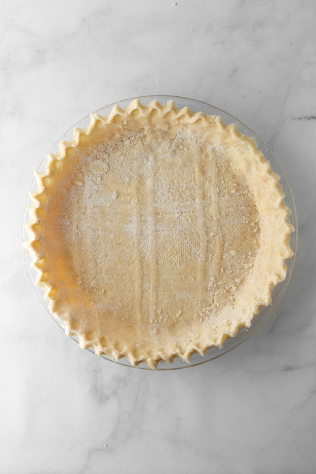 Pie crust on a marble surface.
