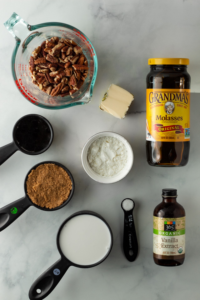 Ingredients for pecan pie on a marble surface.