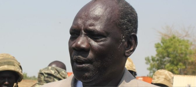 Photo: South Sudan's Information minister Michael Makuei answers journalists' questions upon his arrival at Bor airport, on January 19, 2014 in Bor [Photo via Getty Images]