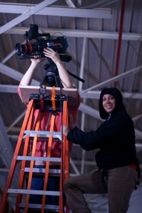 A camera operator and an assistant.