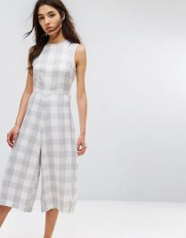 ASOS- http://m.asos.com/native-youth/native-youth-relaxed-jumpsuit-with-tie-waist-in-large-gingham/prd/7210641?iid=7210641&clr=White&SearchQuery=&cid=15370&pgesize=100&pge=1&totalstyles=141&gridsize=2&gridrow=32&gridcolumn=2