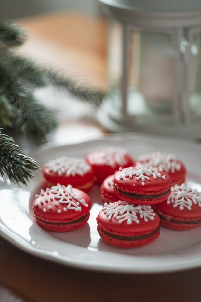 red velvet macaroons on the white plate