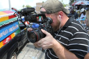 Steve Husmann, videographer, sweating it out in the streets of Haiti