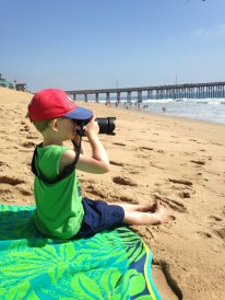 Taking pictures of his mom at Newport Beach