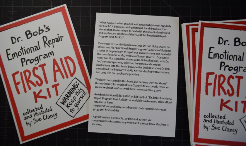 "Postcard about the artist book ""Dr Bob's Emotional Repair Program First Aid Kit"" that I can give to friendly librarians and other people"