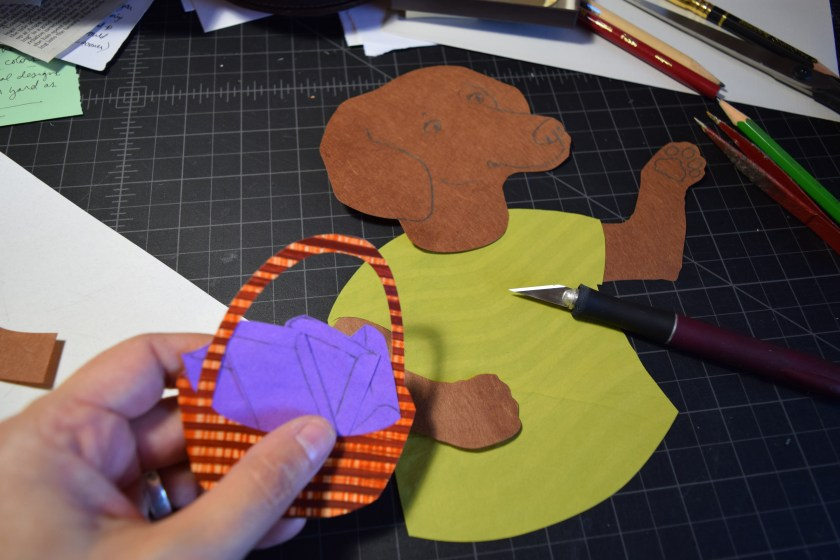 Sue Clancy assembling  a fine art piece with her hand dyed papers that have been cut out in different shapes.