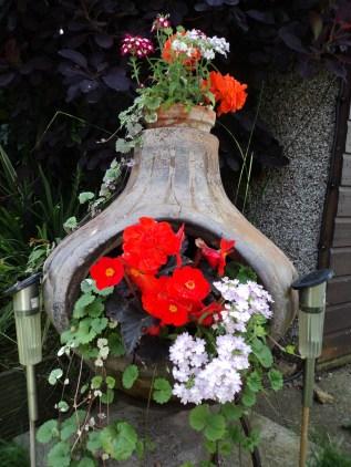 A broken Chimney wood-burner made into a flower Pot.