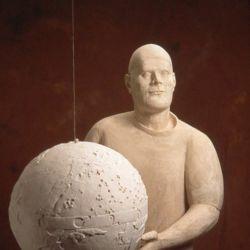 Plaster figure and globe
