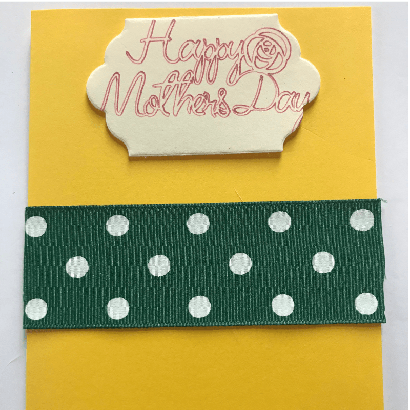 The green polka dot ribbon was attached a little off center in the middle of the card.