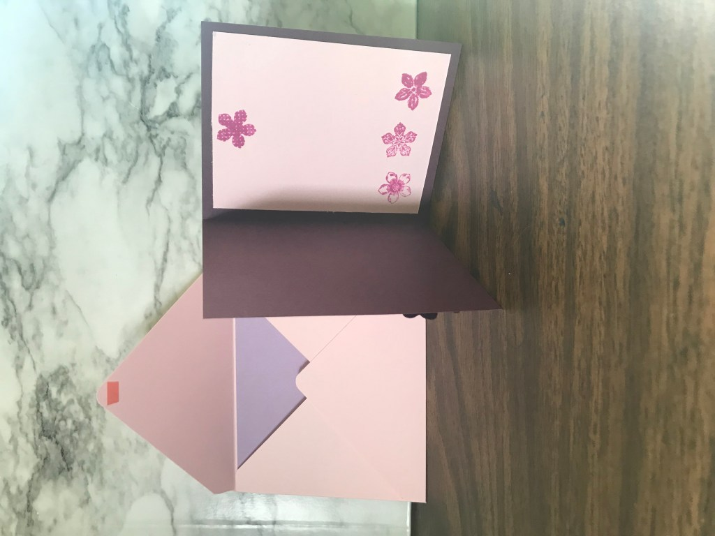 A pink panel was inserted inside of the card so when it is written in, the words will be easier to read. To make it a bit more festive, stamped flowers were added.