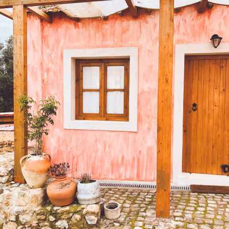 shabby house exterior with wooden door