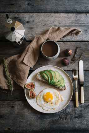 wooden table with delicious breakfast and coffee
