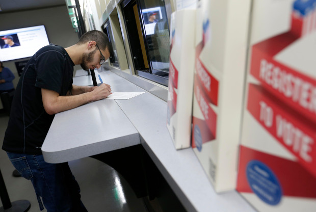 OAKLAND, CALIFORNIA - NOVEMBER 01: Reza Shefa, of Hayward, gets assistance with his conditional ballot at the Alameda County Registrar of Voters in Oakland, Calif., on Thursday, Nov. 1, 2018. Many voters opted to vote early in the midterm elections. (Jane Tyska/Bay Area News Group)