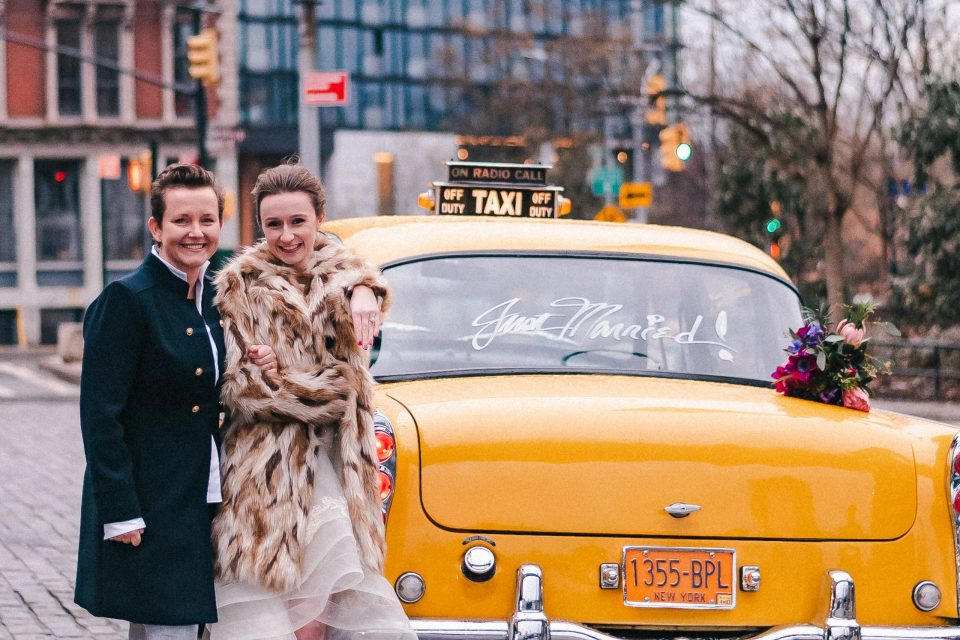 just-married-same-sex-couple-yellow-classic-vintage-checker-nyc-cab-rental-suessmoments