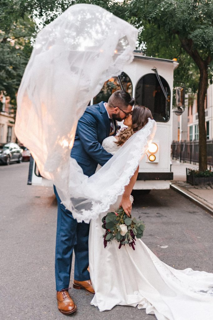 toss-the-veil-photo-white-trolley-nyc-photographer-wedding-photos-suessmoments