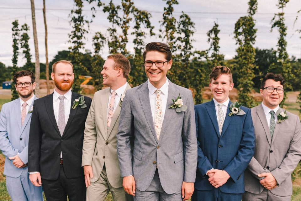 groomsmen-candid-wedding-photo-wearing-different-color-suits-suessmoments