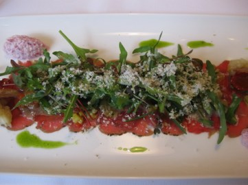Lamb carpaccio with rucola and parmigiano