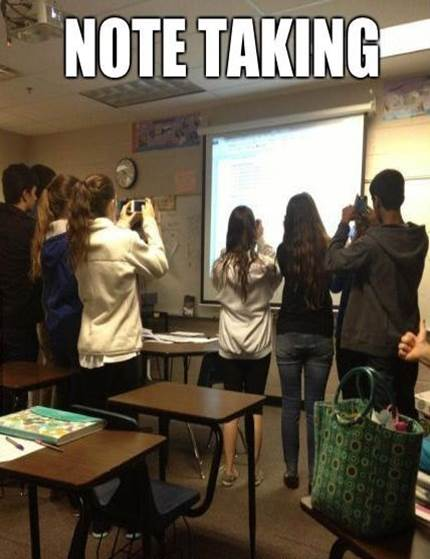 students using mobiles to photograph a presentation rather than taking notes