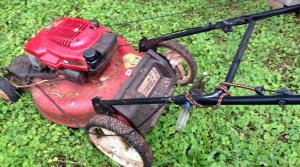 Lawnmower held together with vice grips and bungy cords