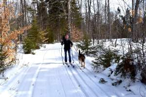 The author skiing with her dog, Quan