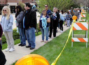 Mourners line up for the memorial for child abuse murder victim AJ Freund