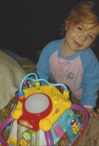 Little Brinley Snyder with a toy