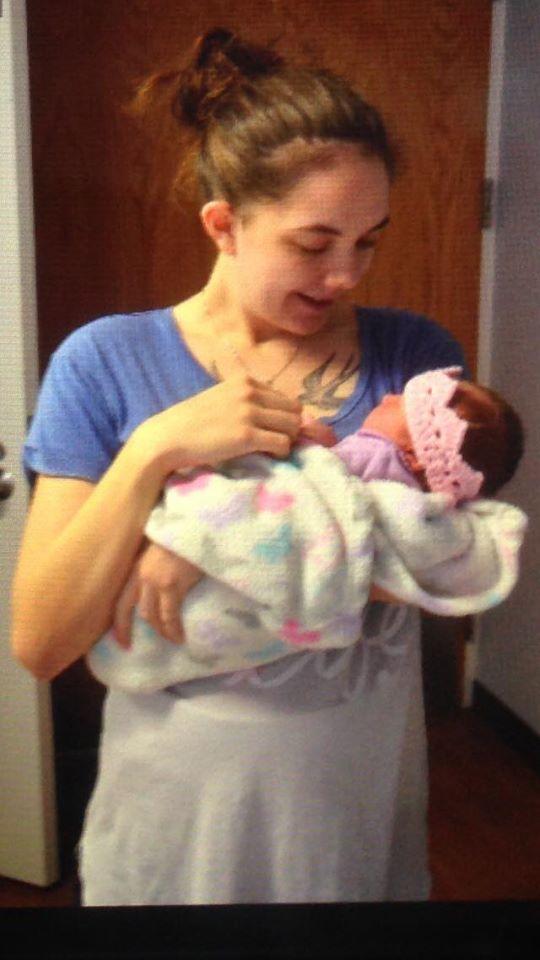 Abigail Neiger-Bickham with daughter Ava Littell wearing a tiara