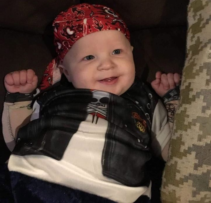 Baby Aiden Leonardo dressed in a do rag and biker vest