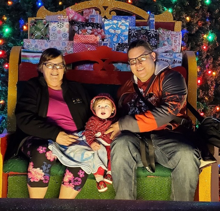 Emilio Montoya, his mother Sheilah (Katie), and baby Marion Jester-Montoya at Christmas