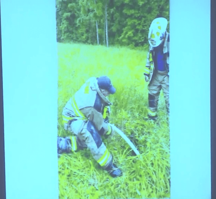 Groves trial: An evidence photo depicting Otway firefighter Steve Gambill attempting to pump water out of the well where Dylan Groves' body was found.