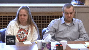 Groves trial: Jessica and Daniel Groves view evidence photos taken at the well site where their son's body was dumped.
