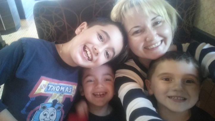 Justyna Zubka-Valva with sons Anthony, Thomas, and Andrew