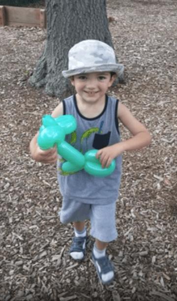 Thomas Valva with balloon animal