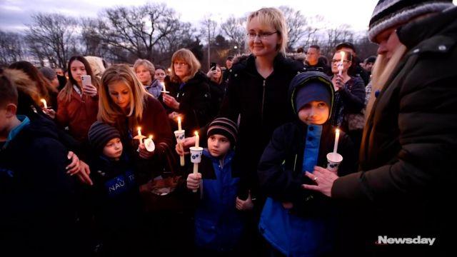 Justyna Zubka-Valva with sons Andrew and Anthony Valva at vigil for Thomas