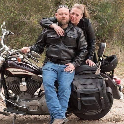 Kris and Jennifer Owens with a motorcycle