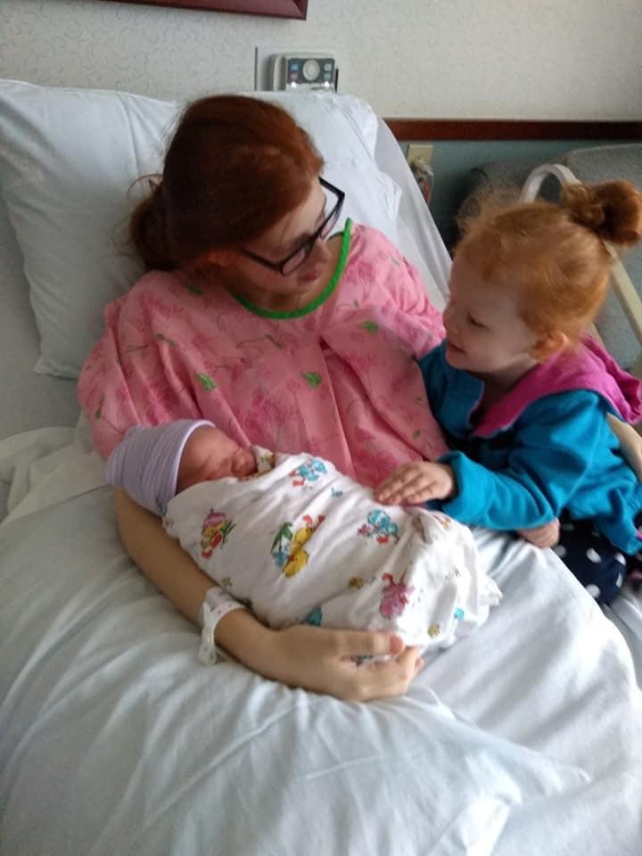 Christina Collado with daughter Autumn Horak and newborn son Greyson.