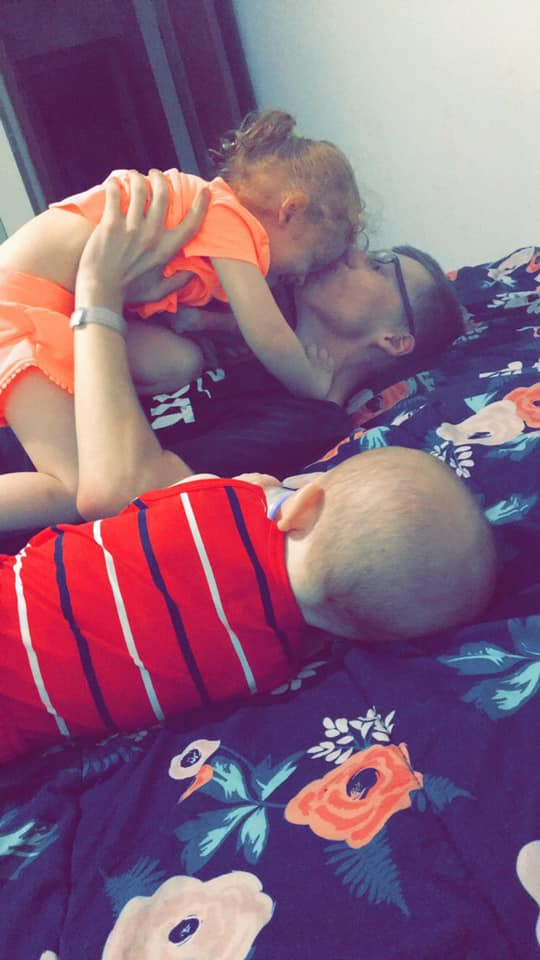 Jerome Millen Jr. playing with Autumn Horak and baby brother Greyson