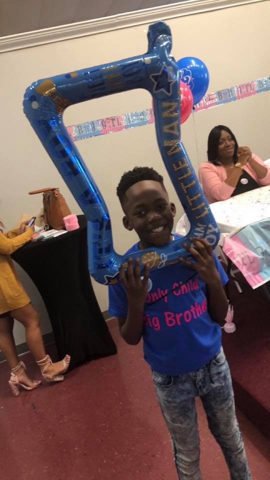 Jordan Mekhi Roberts at a baby shower for his mom