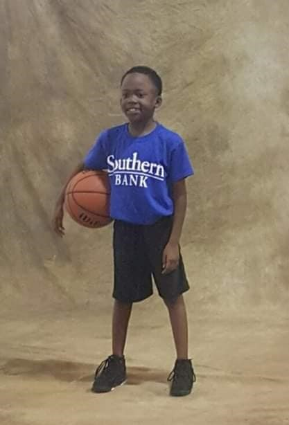 Jordan Mekhi Roberts holding a basketball