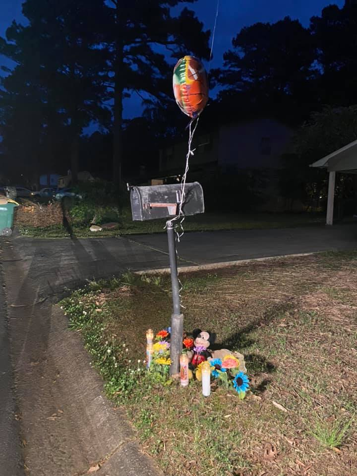 A makeshift memorial on Karon Court for slain Jordan Roberts